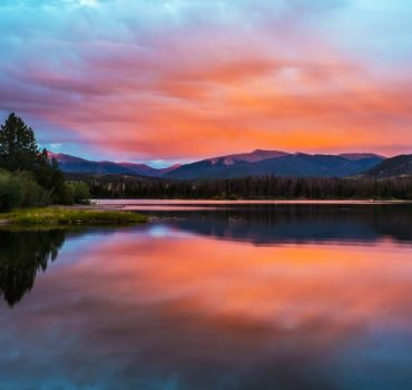 Evening Mountain Glow Over Lake After Sunset With Pink Glow