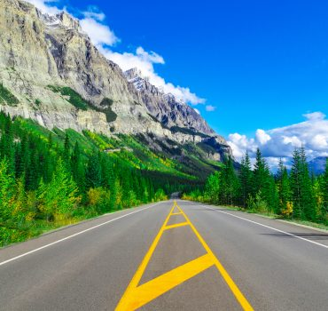 Perfect Asphalt Highway Into Beautiful Mountain Wilderness